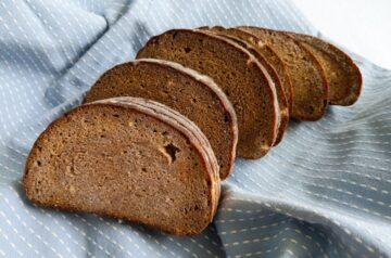 Dark rye bread on a blue tea towel