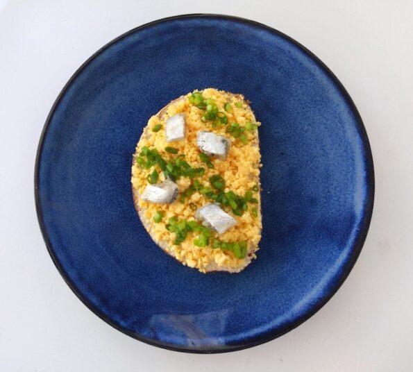 Rye bread open sandwich on a blue plate blue